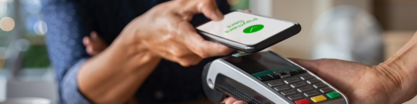 Customer paying with mobile wallet