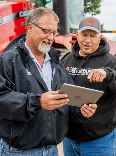 Farmer and banker looking at a tablet